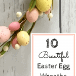 Rustic white wood background with pastel Easter egg wreath with text reading 10 beautiful Easter egg wreaths