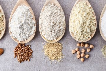 Wooden spoons with grains How to Create a Gluten Free Kitchen in 5 Easy Steps