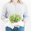 Woman holding washed fresh cabbage