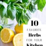Fresh basil and lemons on table with text reading 10 Favorite Herbs for Your Kitchen Garden