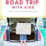 Girl with map sitting in the back of a car with text reading Navigating a Road Trip with Kids